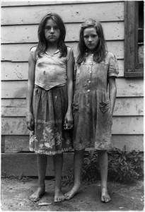 Two girls with dirty clothes holding hands, (c) William Gedney 1964